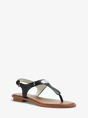 Spring's in full swing, and we're infatuated with this sleek T-strap sandal…