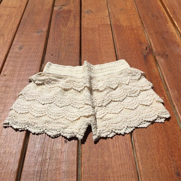 crochet layered shorts New crochet layered shorts. super cute on they look a little like a skirt when wearing.  they run a little small in size.   one pair choose either black or white at check out. thank you colorado chick Shorts