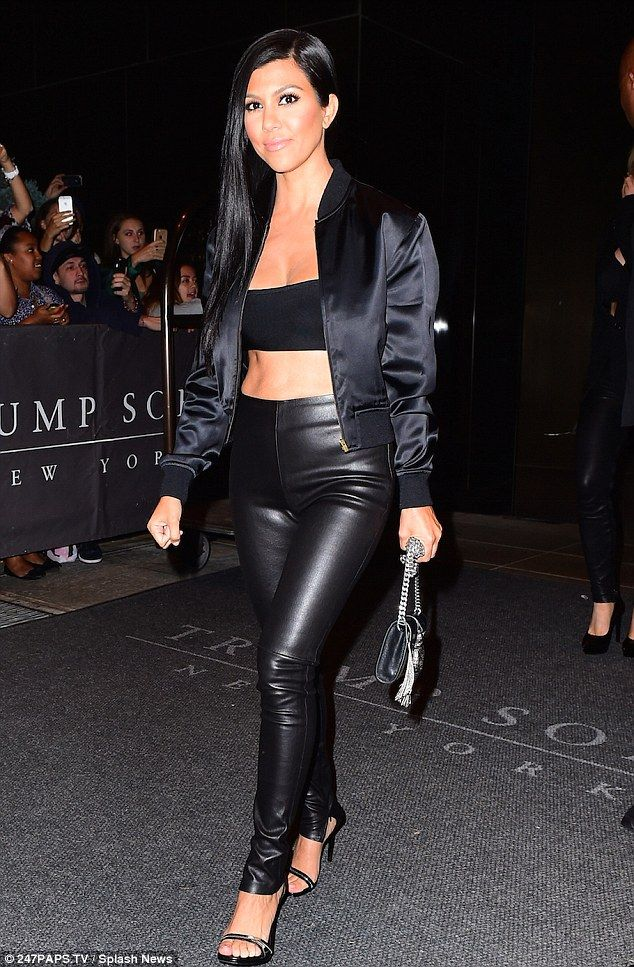 5646945b417310 Kourtney Kardashian shows firm abs in black bandeau and leather pants