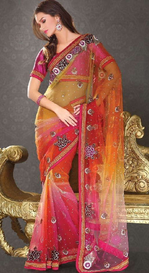 Alluring pink and orange color combination saree is crafted on art silk fabric. Charmingly designed with zari and faux pearl patchwork border accentuated with stones, sequins, resham and zari embroidery. Paired with matching blouse with embroidery and you are officially ready to dazzle.