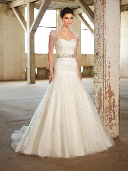 Fit-n-flare gown with Luxe taffeta dropped waist bodice.  Tulle skirt features lace appliques.  Detachable beaded belt included.