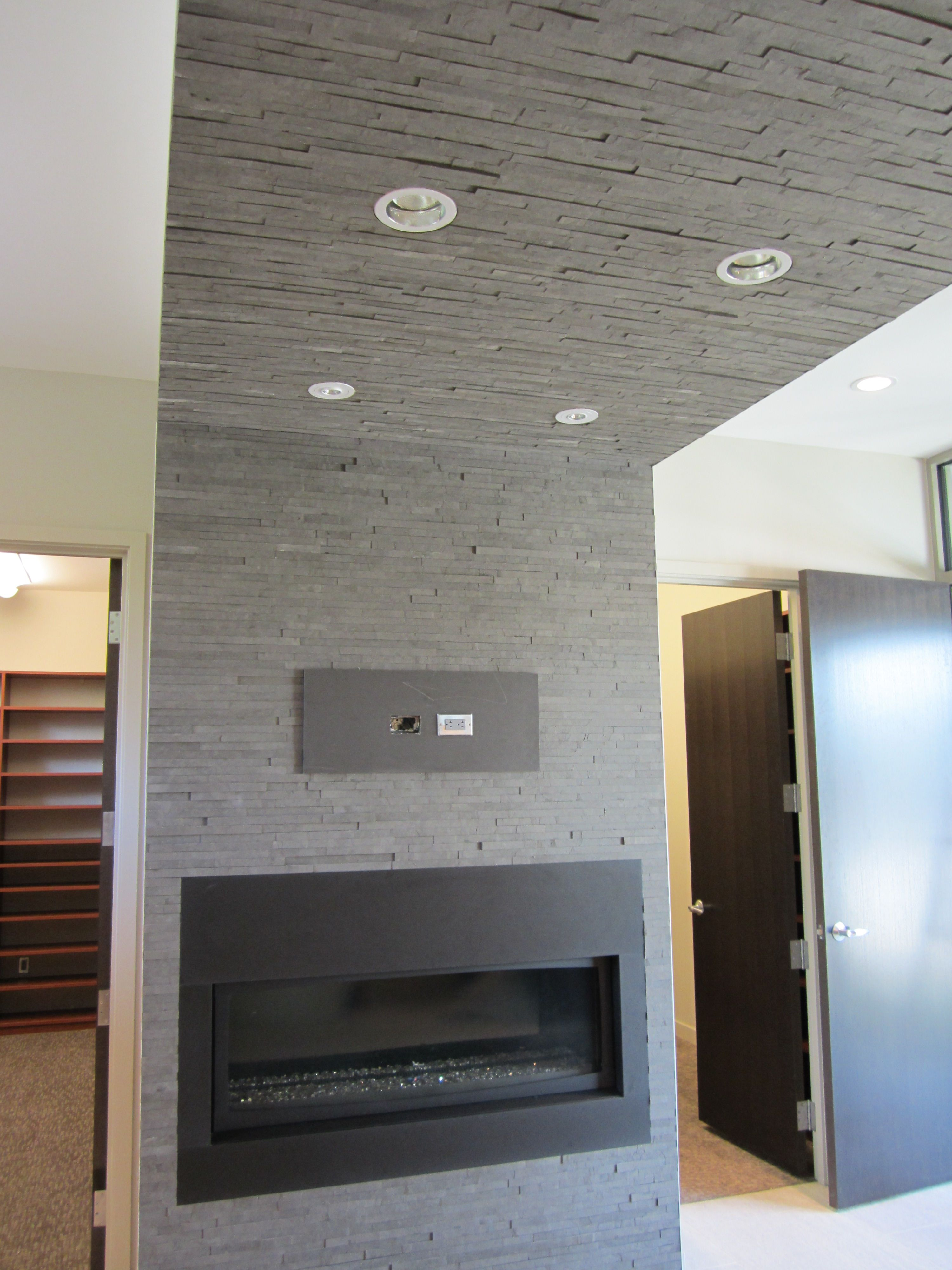 slate ish tile is lightweight enough to do a ceiling looks great
