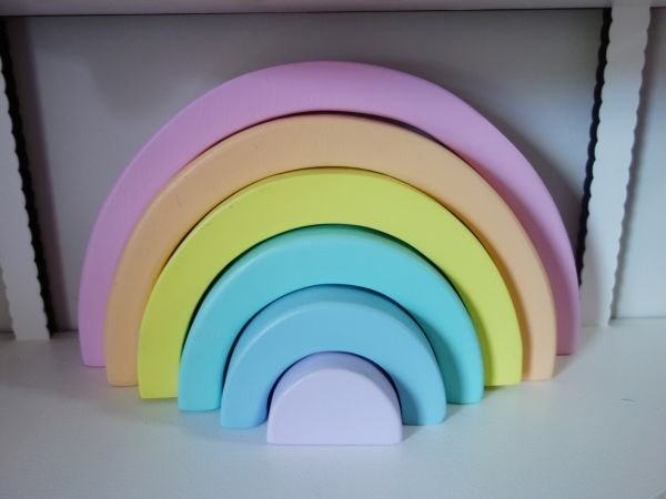 A Gorgeous Set Of 6 Pastel Coloured Wooden Rainbow Stacking Blocks.