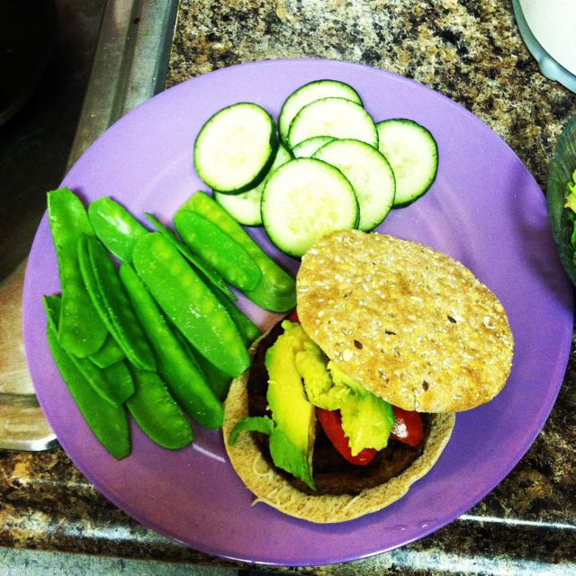 "My new take on ""burger and fries.""  Soy-veggie burger, multigrain sandwich round with snow peas and cucumbers! Yummy and healthy!"