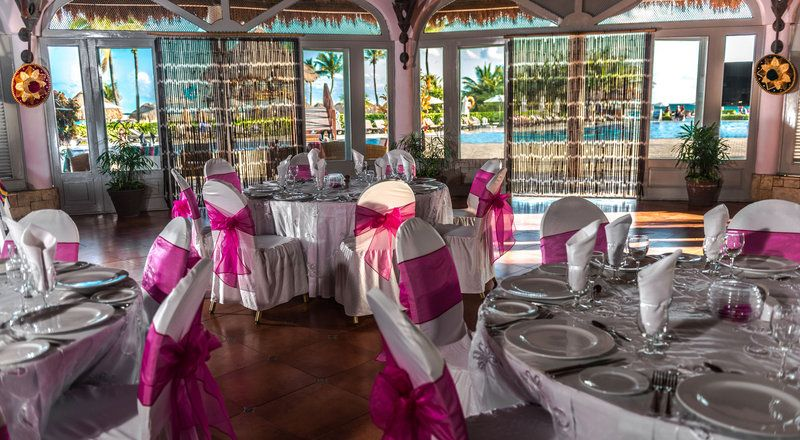 An indoor destination wedding reception with a local flare! This beautiful location is at Ocean Maya Royale in Riviera Maya, Mexico!