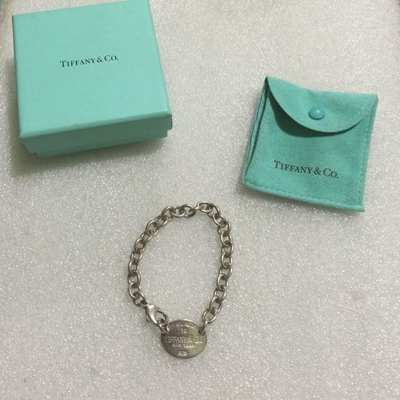 Tiffany&co. Received as a gift and not my style. This is the bracelet. In the center there is a dog tag. It has signature style from designer. Says 925. Comes with bag and box. Used and may need to be cleaned . Tiffany & Co. Jewelry Bracelets