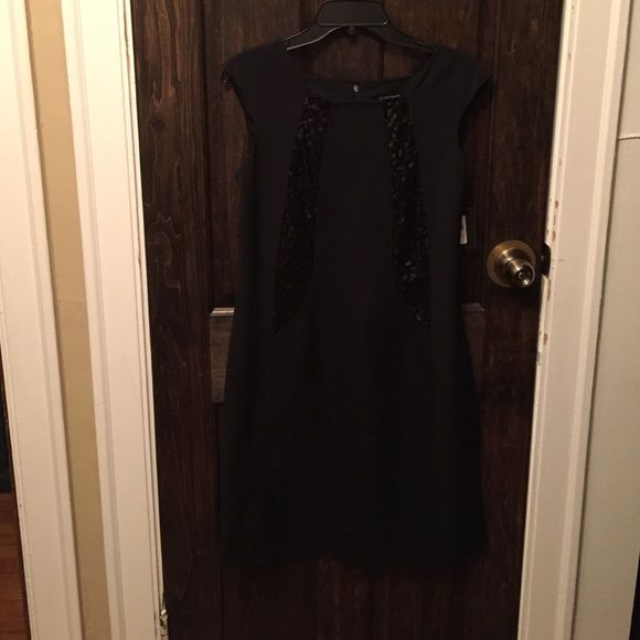NWT Black Cocktail Dress NWT black Ellen Tracy cocktail dress. Has black sequin accents on the front and back-see pics for that detail. Make me a reasonable offer. Ellen Tracy Dresses