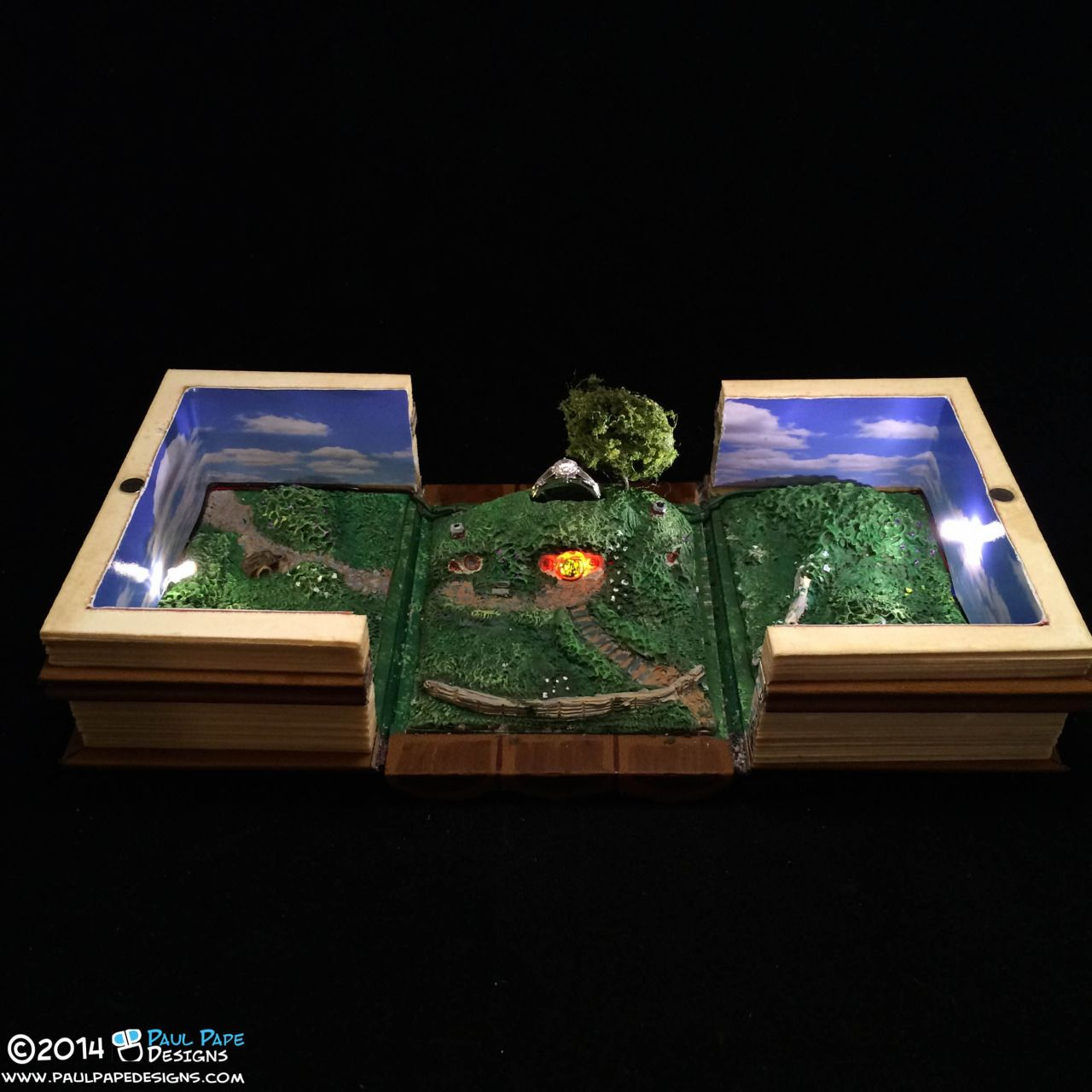 Lord of the Rings Bad End Custom Engagement Ring Box by Paul Pape Designs. This is a ring box based on the J.R.R. Tolkien series the Lord of the Rings. It is a series of books, and then when you open the books you're presented with Bag End in the...
