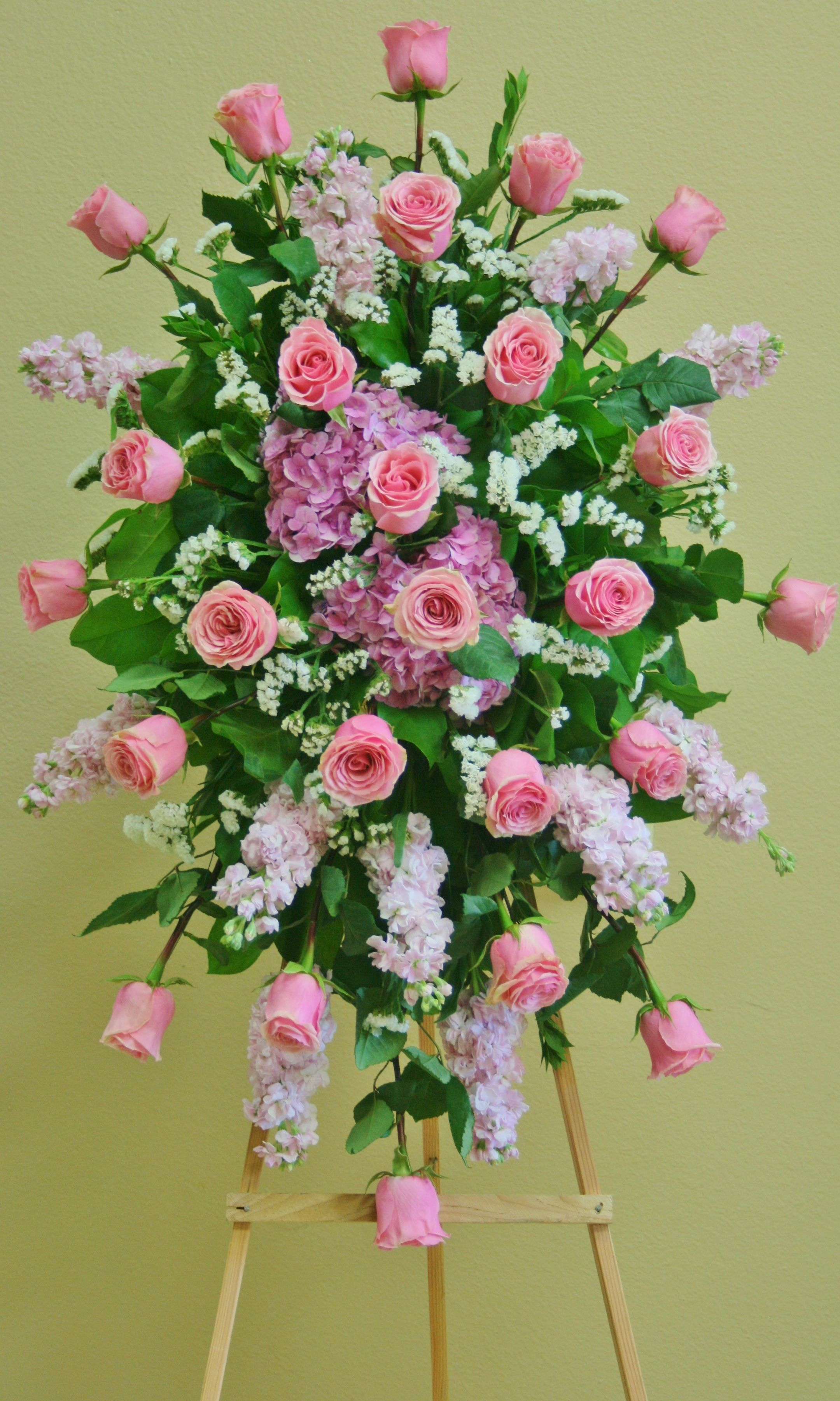 A Standing Spray With Flowers In Shades Of Pink By Your Local