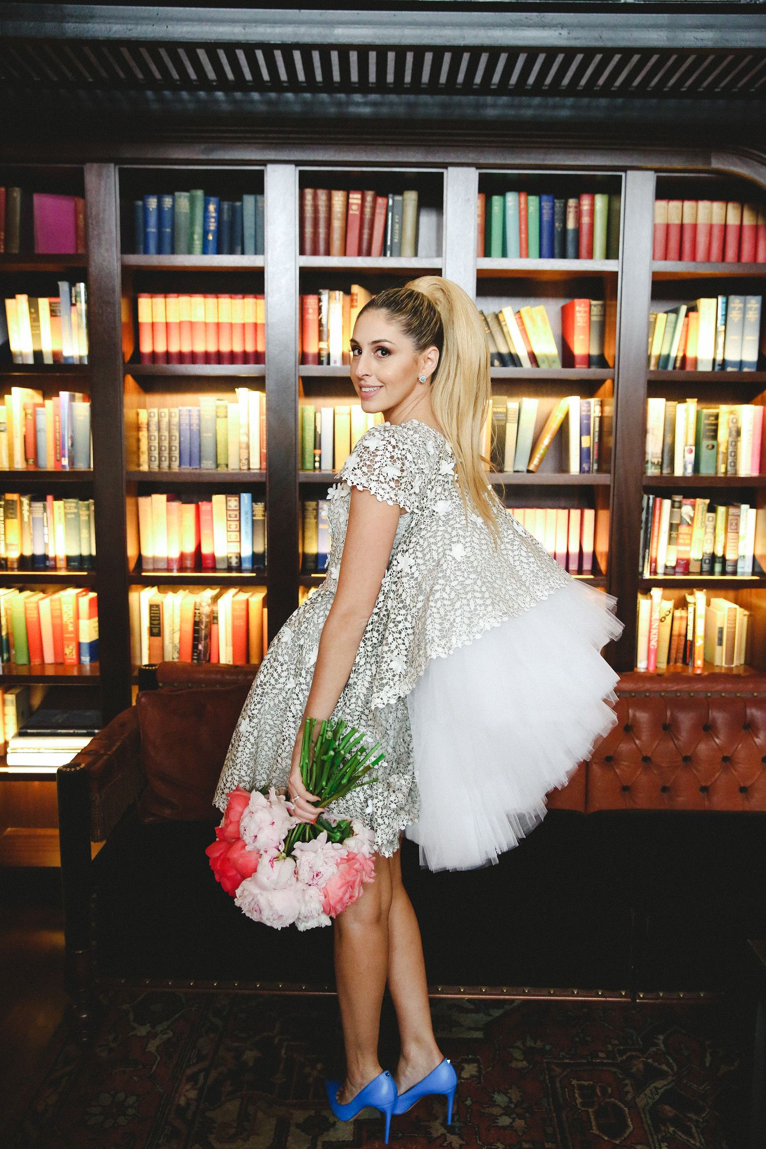 392b9f247e38 Maria Mendez and Patrícia Viera teamed up to create this wow-worthy wedding  dress. Its floral appliqués and a dramatic back definitely turned heads.