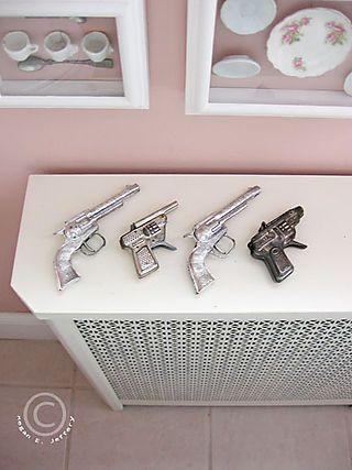 Toy metal guns. From Megan Jeffery's blog, Beetlegrass.