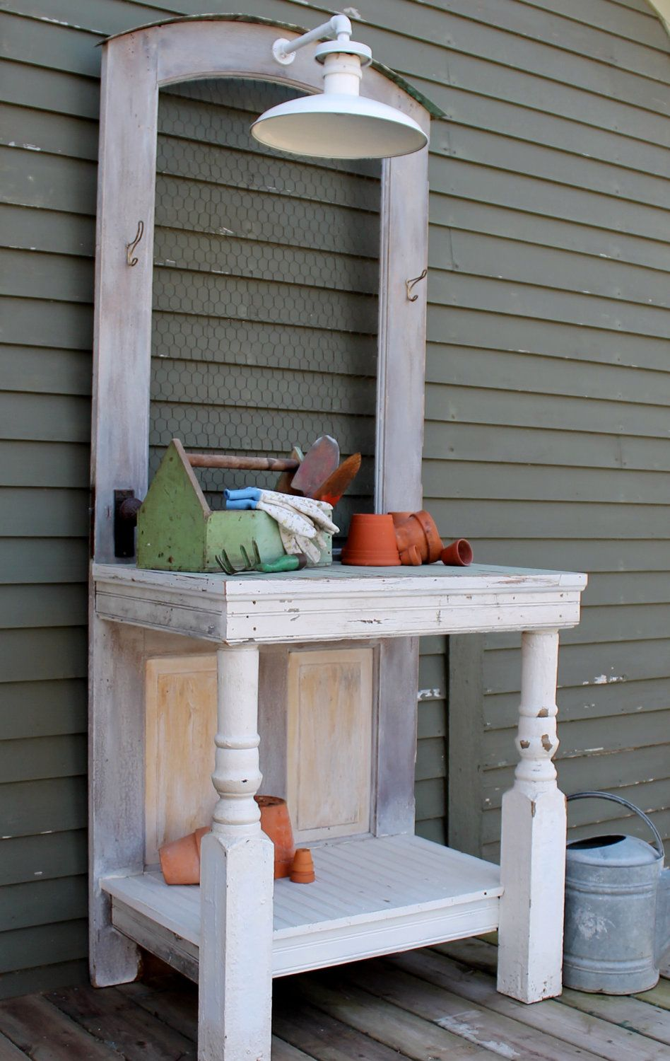 Potting bench has farmhouse light and old door w/ chicken wire ...