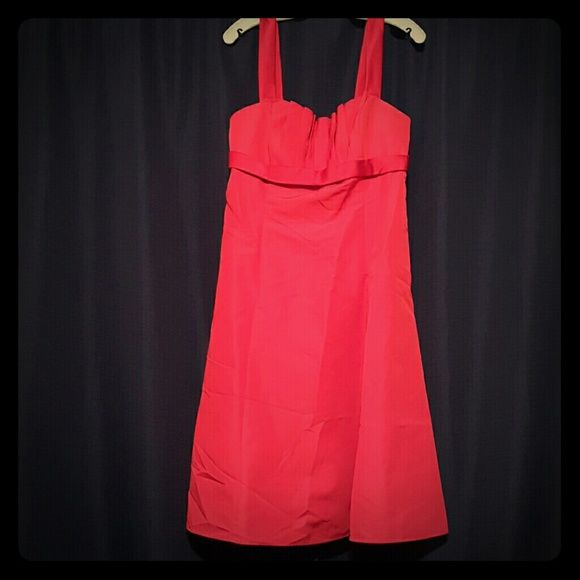 Formal Dress This is a stunning dress that will make you feel completely beautiful. You can wear this beautiful apple red dress to the prom, in a wedding, to a party, at a banquet....no matter where it is you wear it, I'm sure you will be receiving compliments on this knee length dress. David's Bridal Dresses Prom