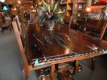 mesquite dining table with crushed turquoise inlay where the wood