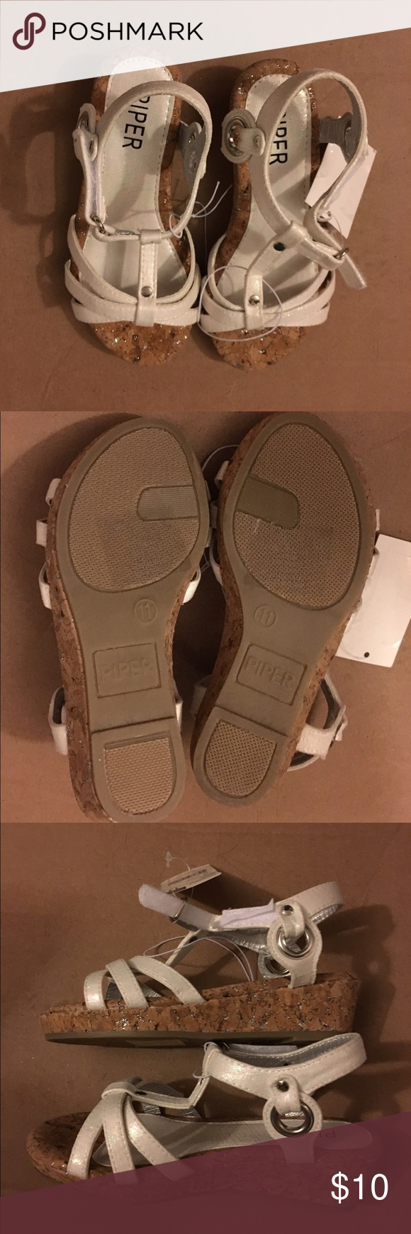 NWT Piper White Bina Wedge Toddler Sandals 11 Med NWT toddler girls Piper Bina Wedge White Sandals are size 11 Medium Width. They are white with cork like wedges brown color with silver glitter. Shoes have Velcro Closure and made in China of all man made materials. Piper Shoes Sandals & Flip Flops