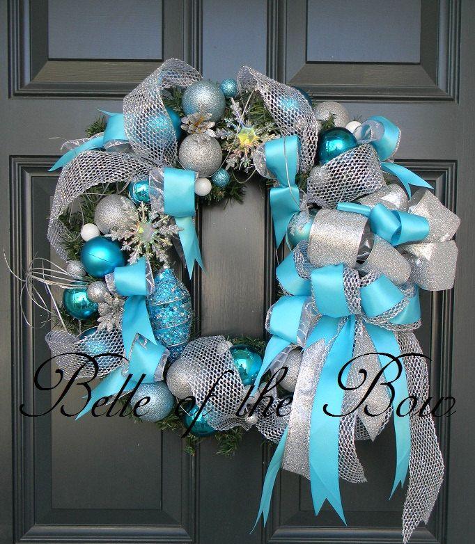Ice Blue & Silver Winter Wonderland Christmas Wreath, Snow Wreaths, Large Christmas Bow. $79.99, via Etsy.
