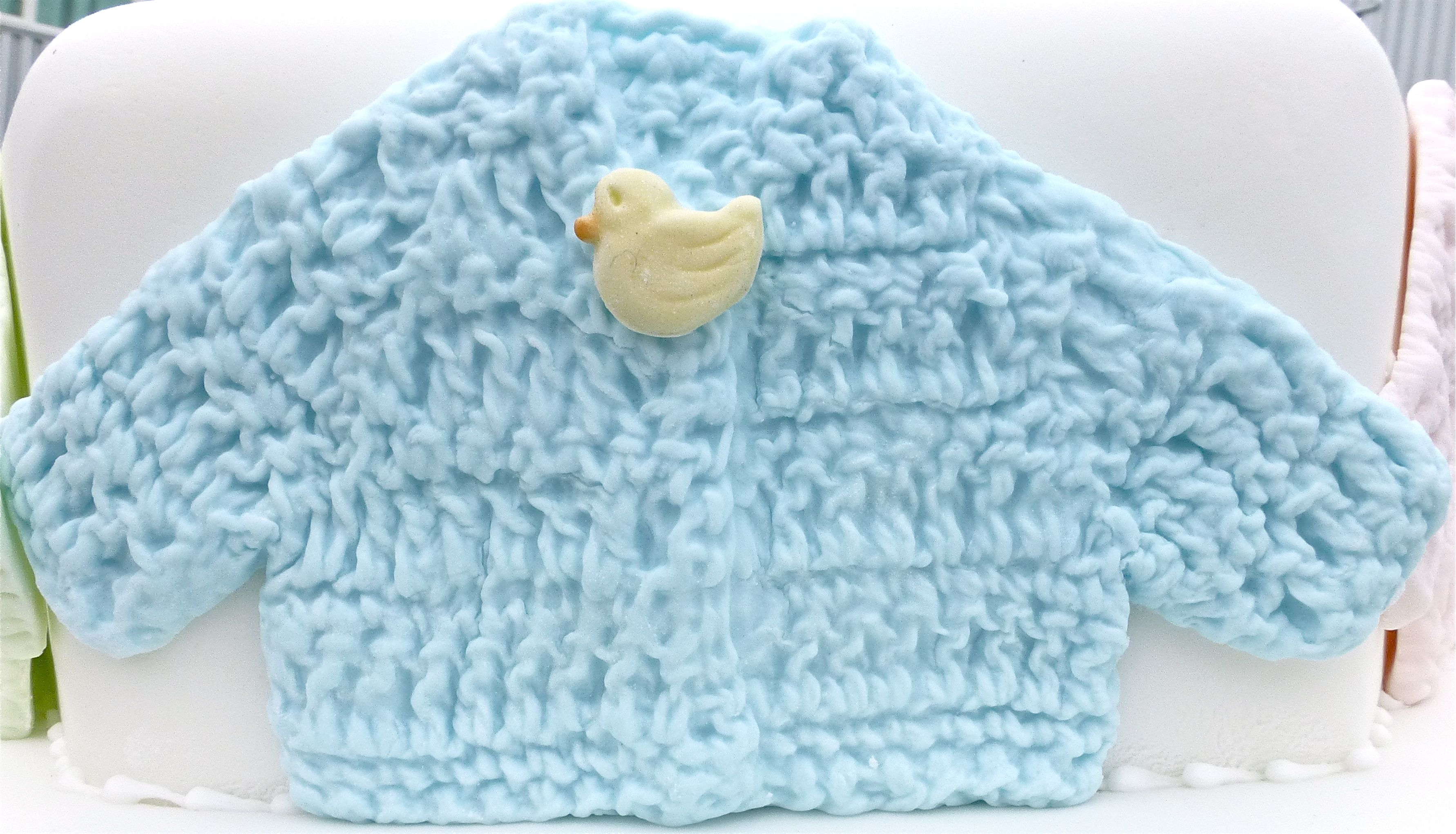 Our Crochet Jacket can be decorated in many ways. Makes a cute accessory for Christening cakes. Try adding buttons from our Baby Button Mould to make it even cuter!  http://www.karendaviescakes.co.uk/Moulds/?p=208_Baby_Jacket