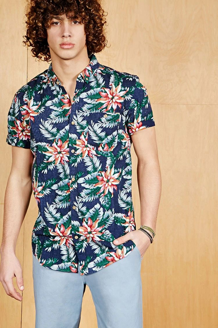 ce9849047e1 A woven Hawaiian shirt by Soul Star™ featuring an allover tropical ...