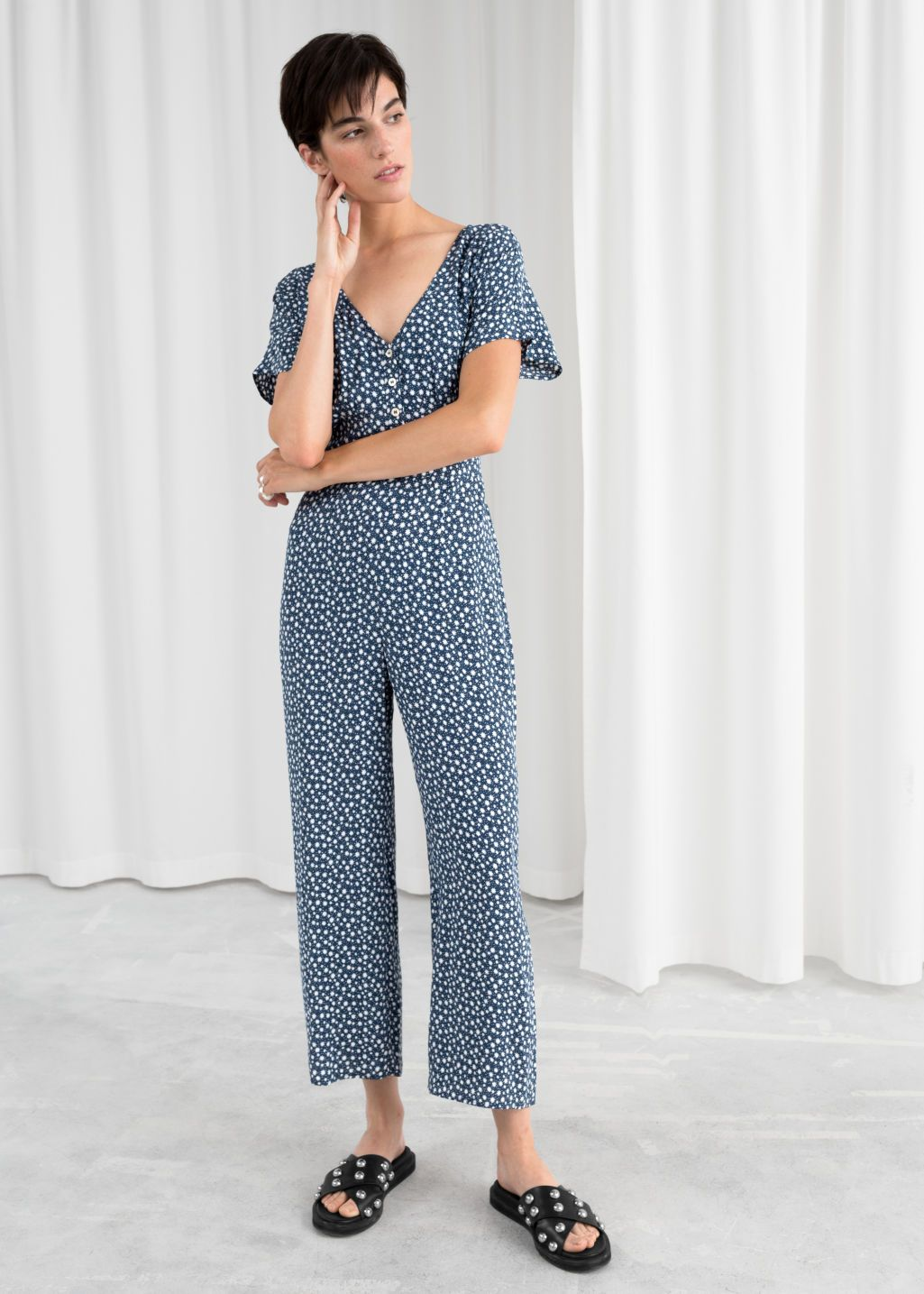 88a3870970f4 Model front image of Stories in blue. Model front image of Stories in blue  Floral Jumpsuit