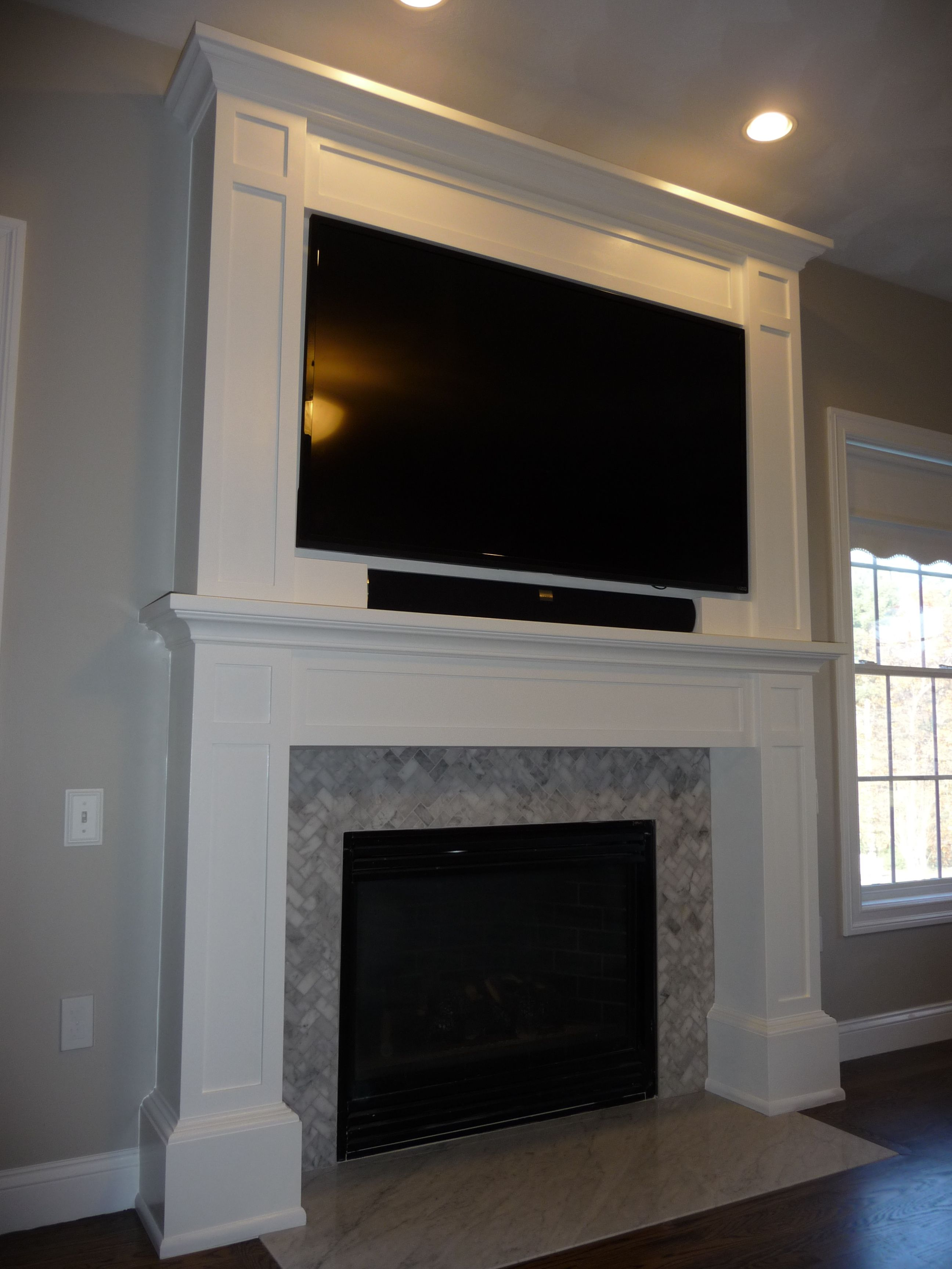 Custom Mantle Tv Cabinet W Herring Bone Carrera Tile