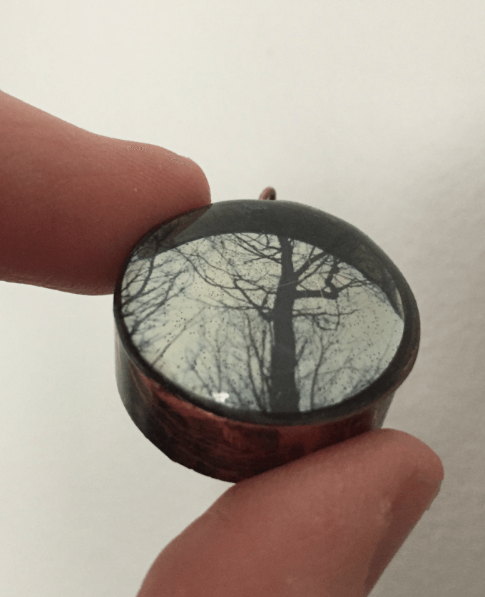 resin and transparency in a metal bezel