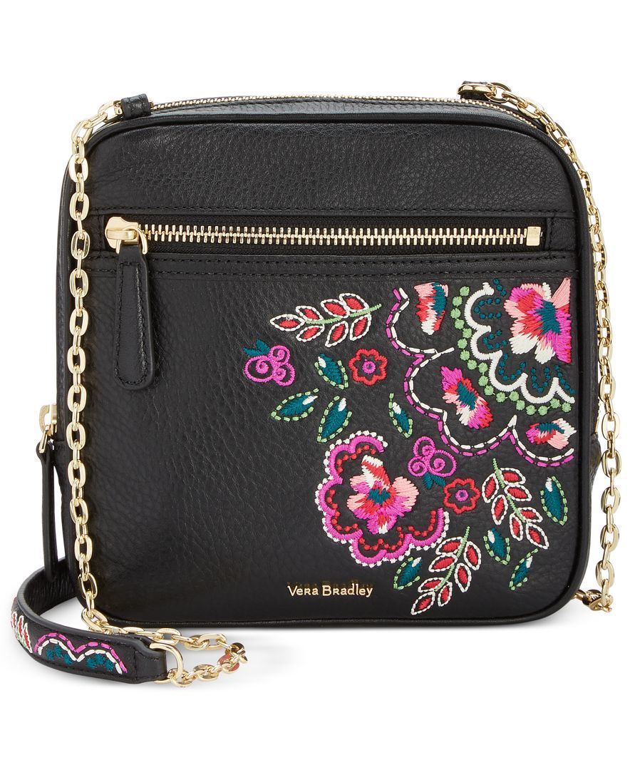 32ba95c35bd4 Vibrant embroidery adds signature whimsy to a compact Vera Bradley crossbody  hung from bright chain-links and secured with a gilded zip.