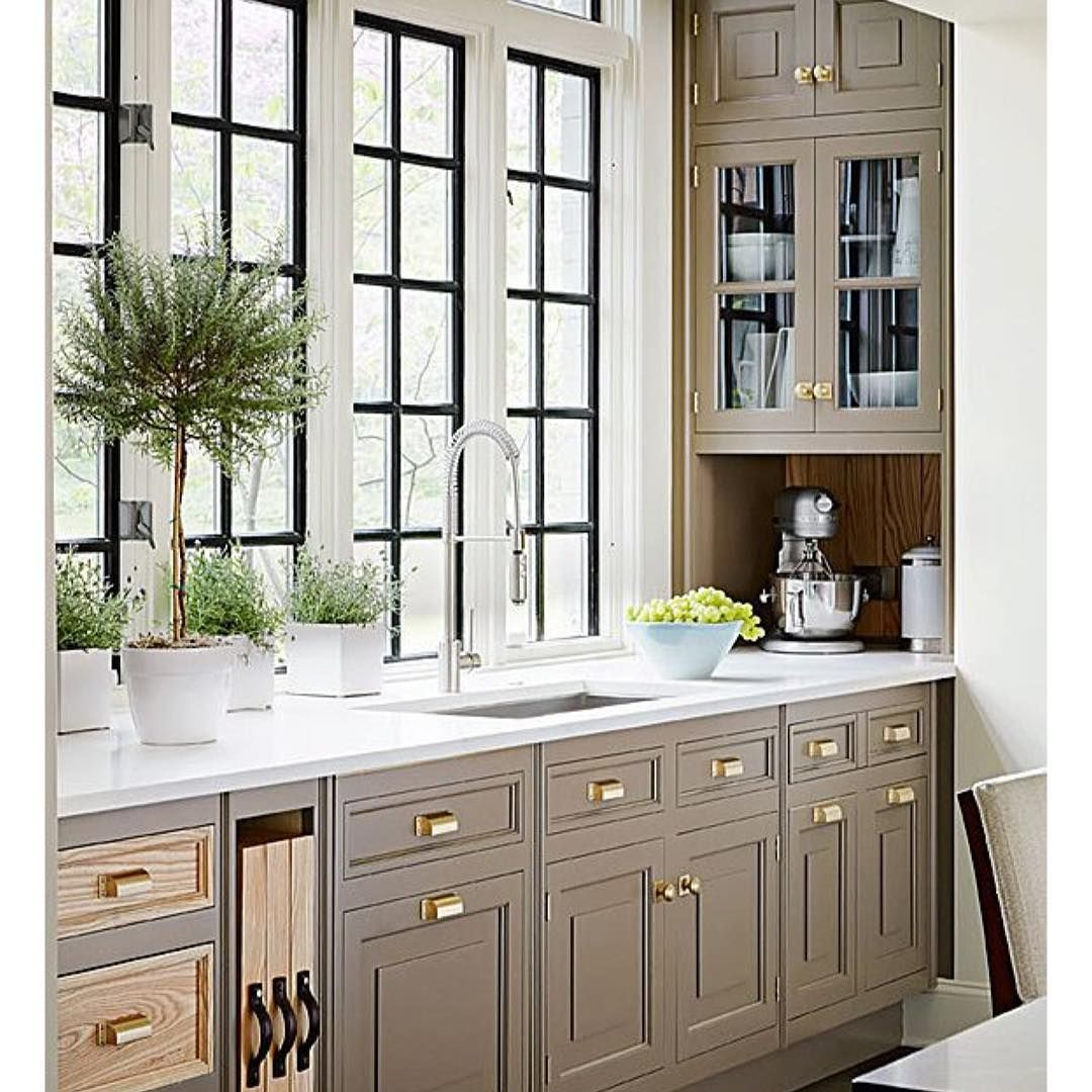 What's not to love about this kitchen? The iron Windows…