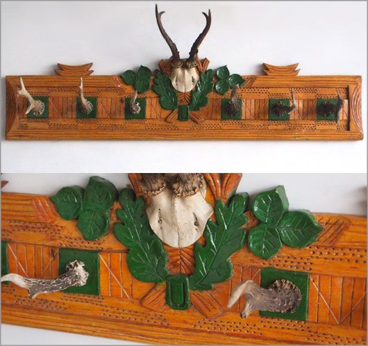 Large vintage German carved pine coathook rack with antler hooks