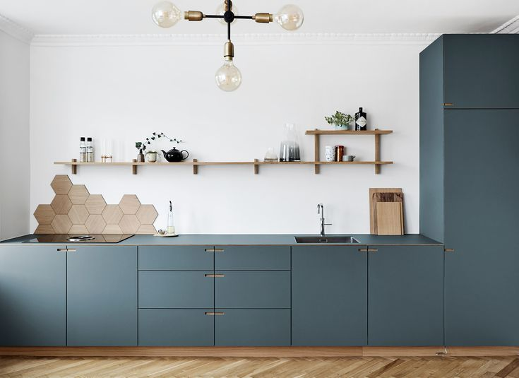 Photo of Carpenter kitchen in oak and pewter gray linoleum – designed and produced by kitchens…