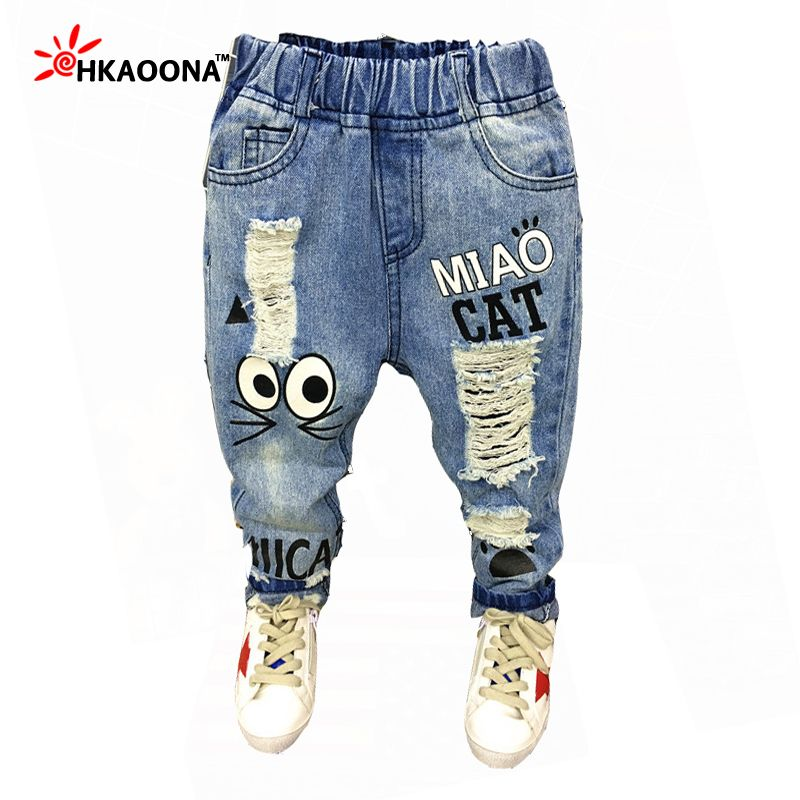 89dd296a672 New 2017 Spring Children s Jeans Cartoon Cat With Pocket With Letters Loose  Holes Hollow Out Boys Pants Child s Summer Trousers
