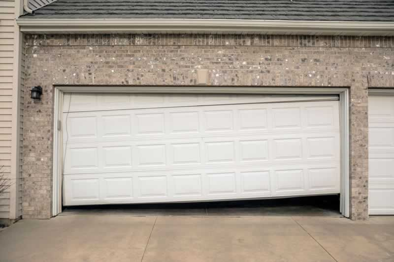 Common Problems With The Spring Of Garage Doors Handyman Tips Garage Door Springs Garage Doors Garage Door Cost