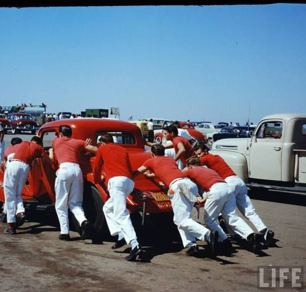 """Snap shot of the """"Sounds by Rocket"""" car & crew at Santa Ana Drags-- late 50s."""