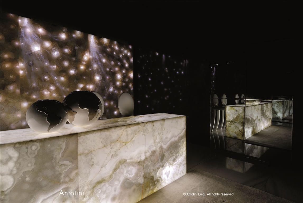 Onyx Back Lit Reception Desk Globs Mirror Glowing Back
