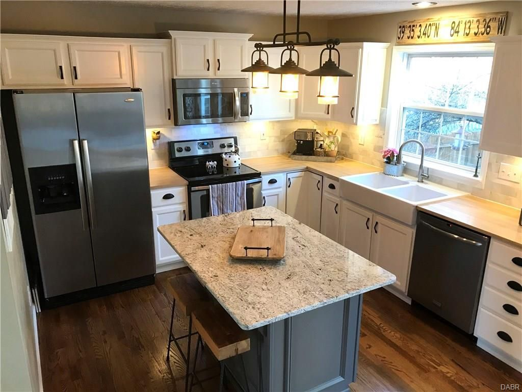 White Painted Cabinets Black Hardware And Lighting Gray Island With R Kitchen Cabinets With Black Appliances White Cabinets With Granite Paint Cabinets White