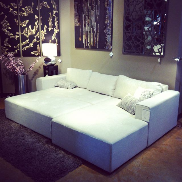 A Rectangular Ottoman Turns This Sectional Into A Living Room Bed