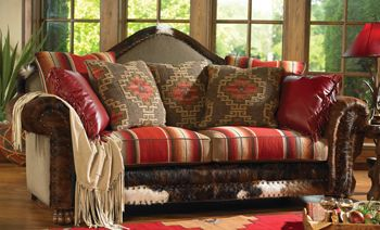 A Sweeping Camelback Sofa With Overstuffed Cushions In A