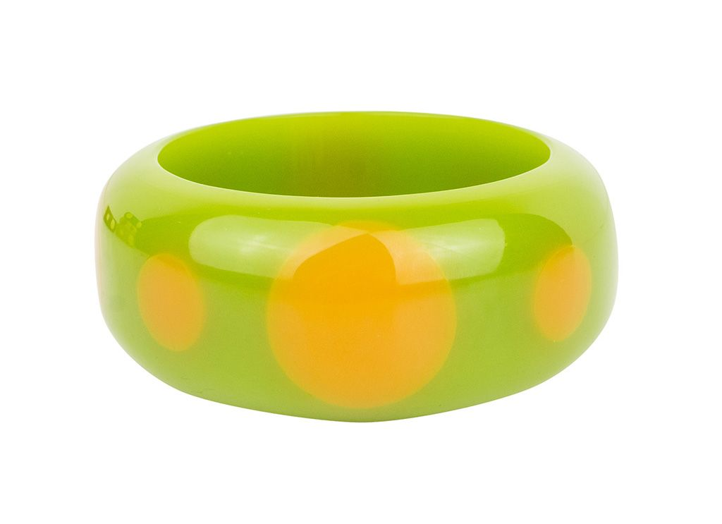 Slip on some true vintage-inspired style with the green and orange De Luxe Polka Dot Bangle.