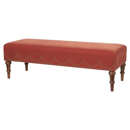Upholstered bench with nailhead trim and turned feet.   Product: BenchConstruction Material: Wood and polyester