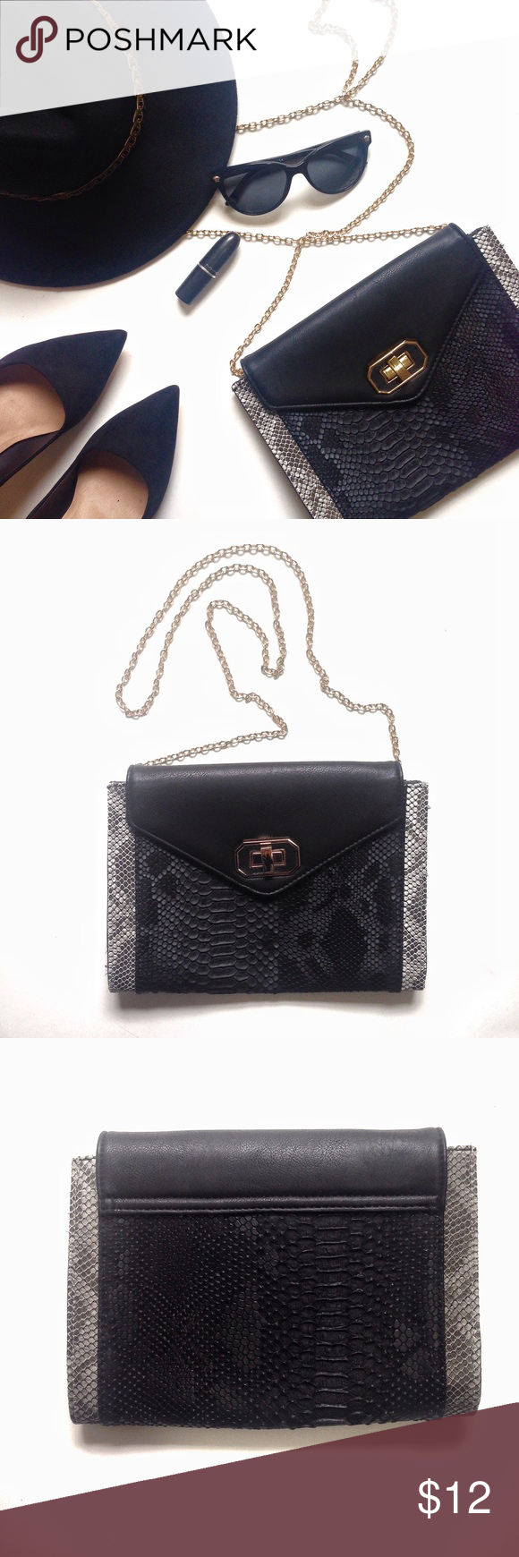 Snake Print Clutch This beautiful envelope clutch comes in black faux snakeskin, twist and lock closure, detachable gold chain strap and interior zipper pocket. There is plenty of room for the essentials. Fully lined. Never worn. Lock closure has a few scratches. Bags Clutches & Wristlets