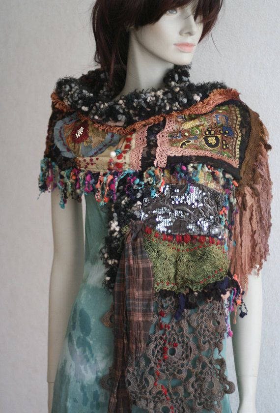 Extravagant bold shawl, with a bohemian nomadic flair. Intricate details and subtle hues with lush shades and rustic details make this shawlette fun and unique. Base of this soft shawl is made from nuno felted cotton and vintage black lace. Other textiles include vintage French laces, torn silks, velvet, antique silk embroidered appliques.. materials are sculpted, stitched and embroidered into organic piece using hand sewing, machine and hand stitching to create intricate surface textures…