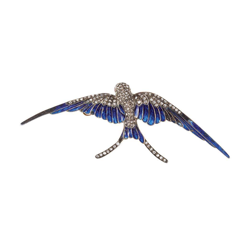 Antique Silver, Gold, Diamond and Blue Enamel Swallow Brooch   Rose-cut diamonds.
