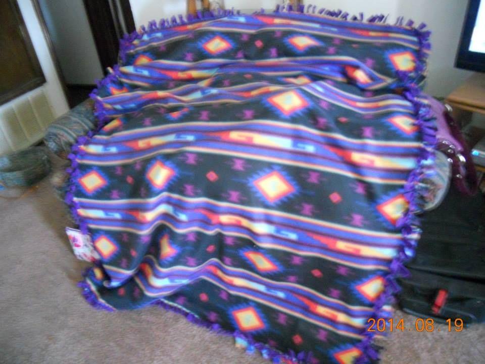 A large size handmade fleece tie blanket in beautiful