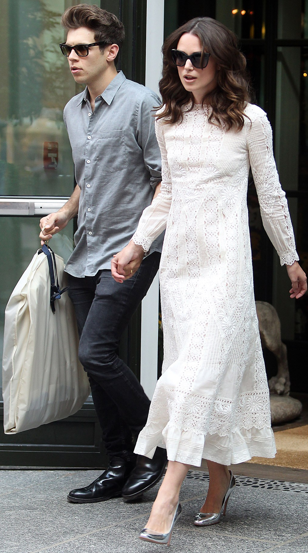 Keira Knightley, joined by husband James Righton, wearing a Valentino pre-spring/summer 2015 dress and silver shoes.