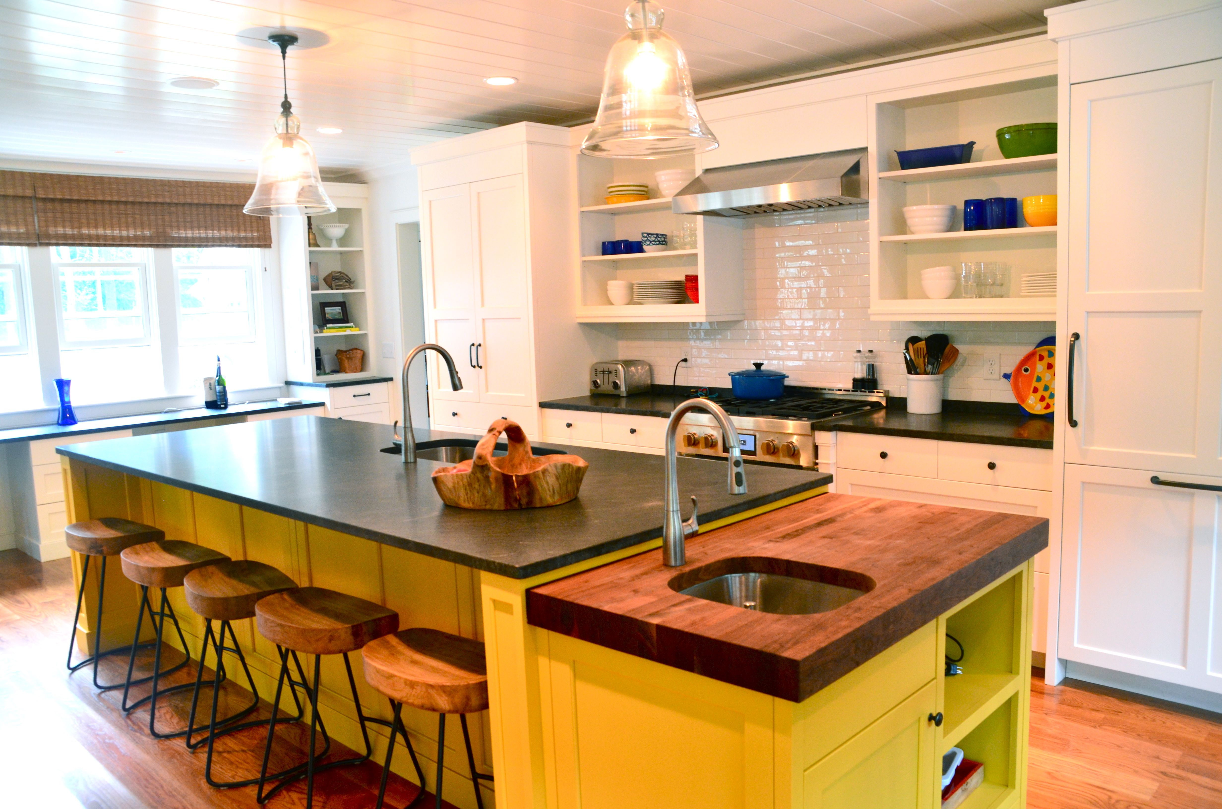 beach house kitchen, colorful kitchen, yellow island, butcher block counter, open shelves, jet mist honed granite countertops, integrated built in refrigerator