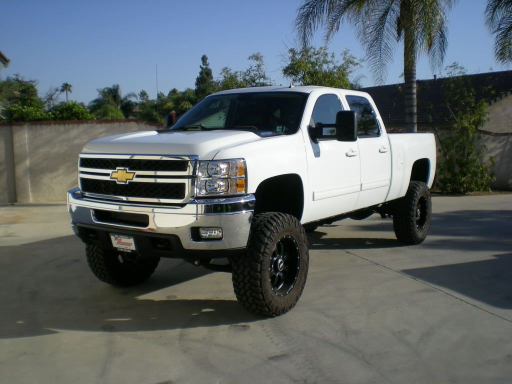 jacked up white chevy trucks - photo #31
