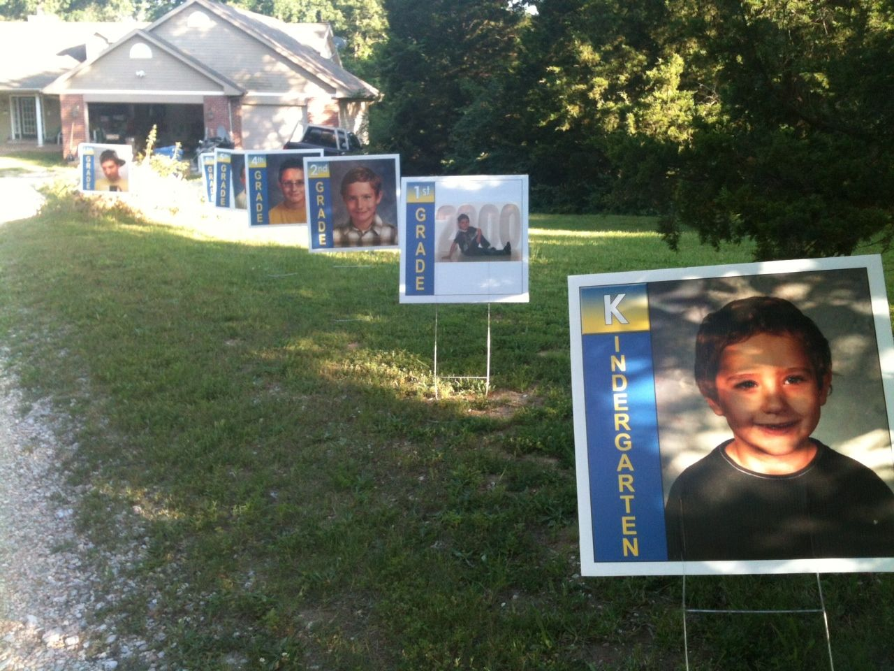 Graduation party ideas sign boards driveways and kindergarten my sister in law took pictures from kindergarten thru senior and put them on sign board we decorated the driveway to the house for my sons graduation biocorpaavc Images