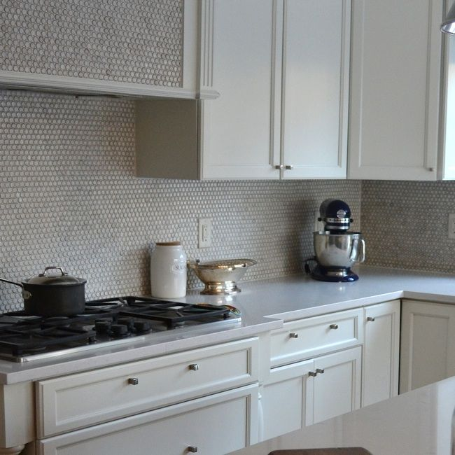 White And Gray Kitchen Features Creamy White Shaker Cabinets Paired With Pale Gray Quartz Grey Tile Backsplash Kitchen Penny Tile Backsplash Grey Kitchen Tiles