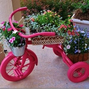 65 Creative Flower Garden Ideas is part of Upcycled planter, Garden, Flower planters, Flower garden, Tricycle, Apartment garden - Give your yard a colorful makeover with these flower garden ideas  From flower planters to landscaping ideas, there are many ideas for inspiration