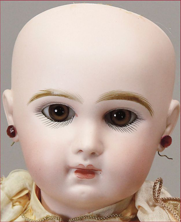 JUMEAU French Bébé, Tété Jumeau, very fine bright biscuit porcelain, light brown fixed glass eyes, closed mouth, pierced ears,