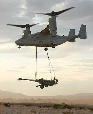 An MV-22B carrying a M-777 howitzer as an under slung load. The aircraft can lift up to 15,000lbs on its dual cargo hooks.